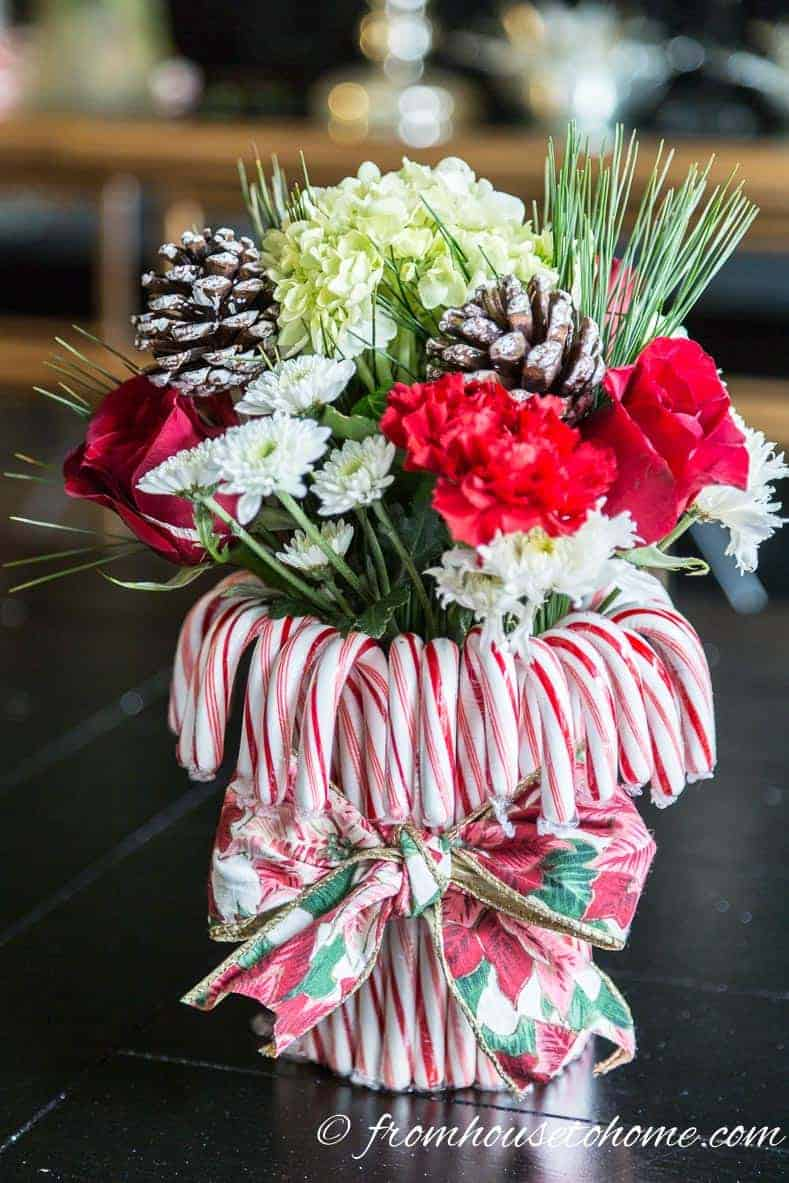 The finished centerpiece | Add some holiday spirit to your Christmas table decor with this red and white DIY candy cane Christmas centerpiece! | DIY Quick and Easy Candy Cane Christmas Centerpiece