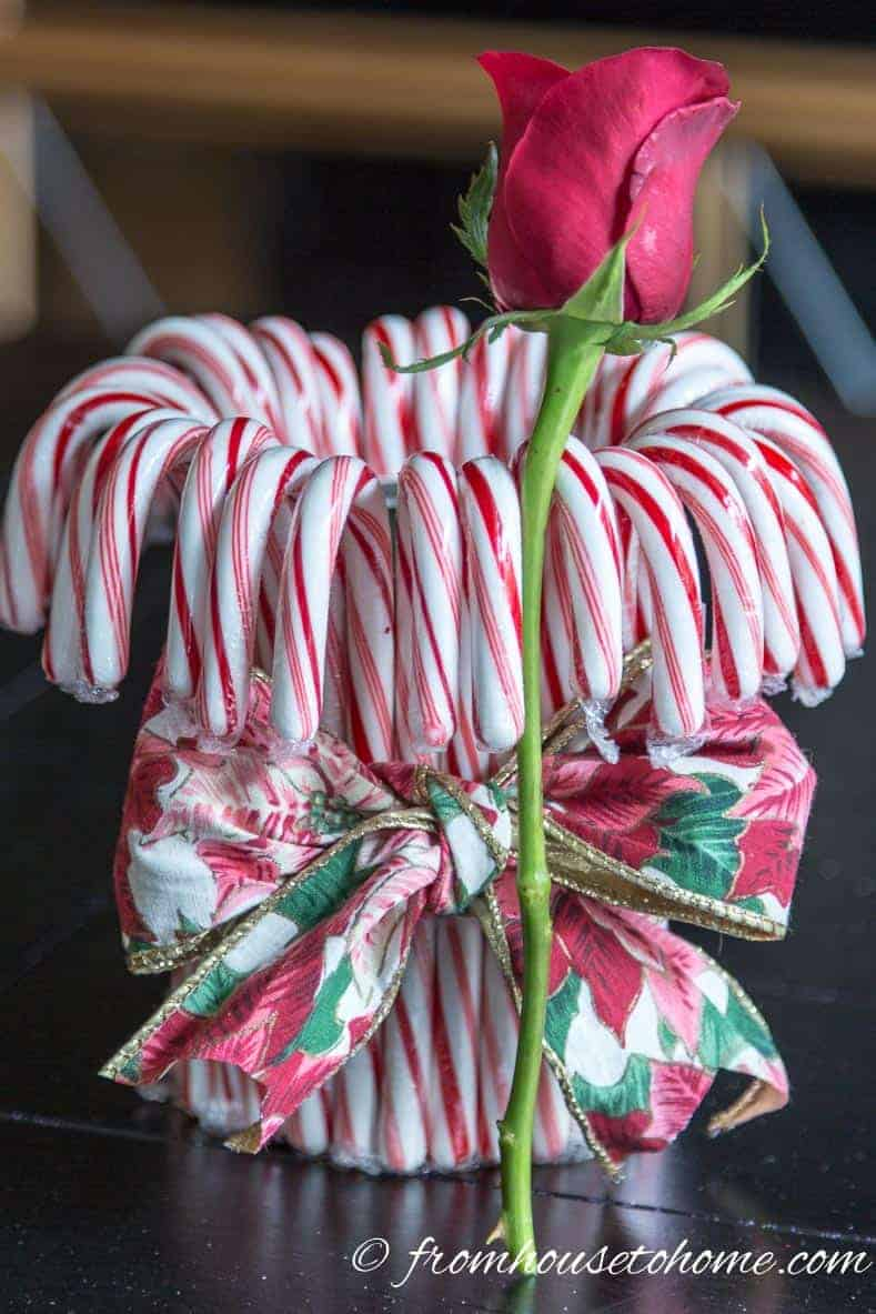 Cut the flowers a little taller than the height of the can | Add some holiday spirit to your Christmas table decor with this red and white DIY candy cane Christmas centerpiece! | DIY Quick and Easy Candy Cane Christmas Centerpiece