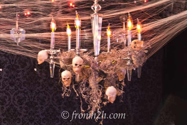 Spanish moss and skulls add spookiness to your chandelier