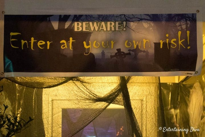 Halloween banner hung above the door