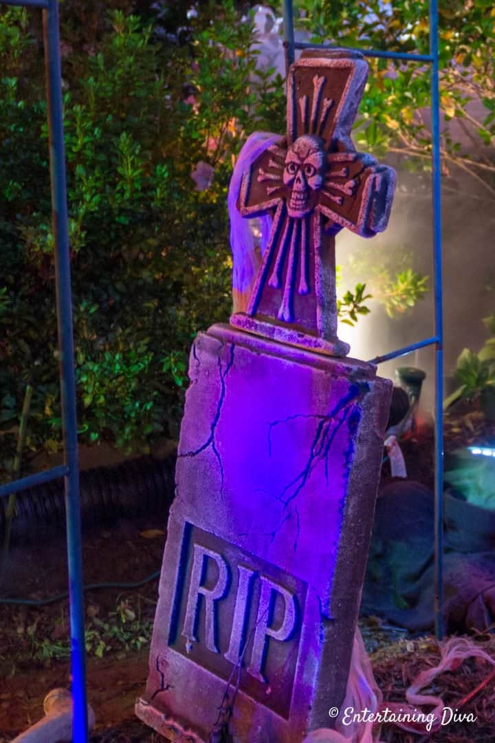 Halloween graveyard RIP tombstone with blue light