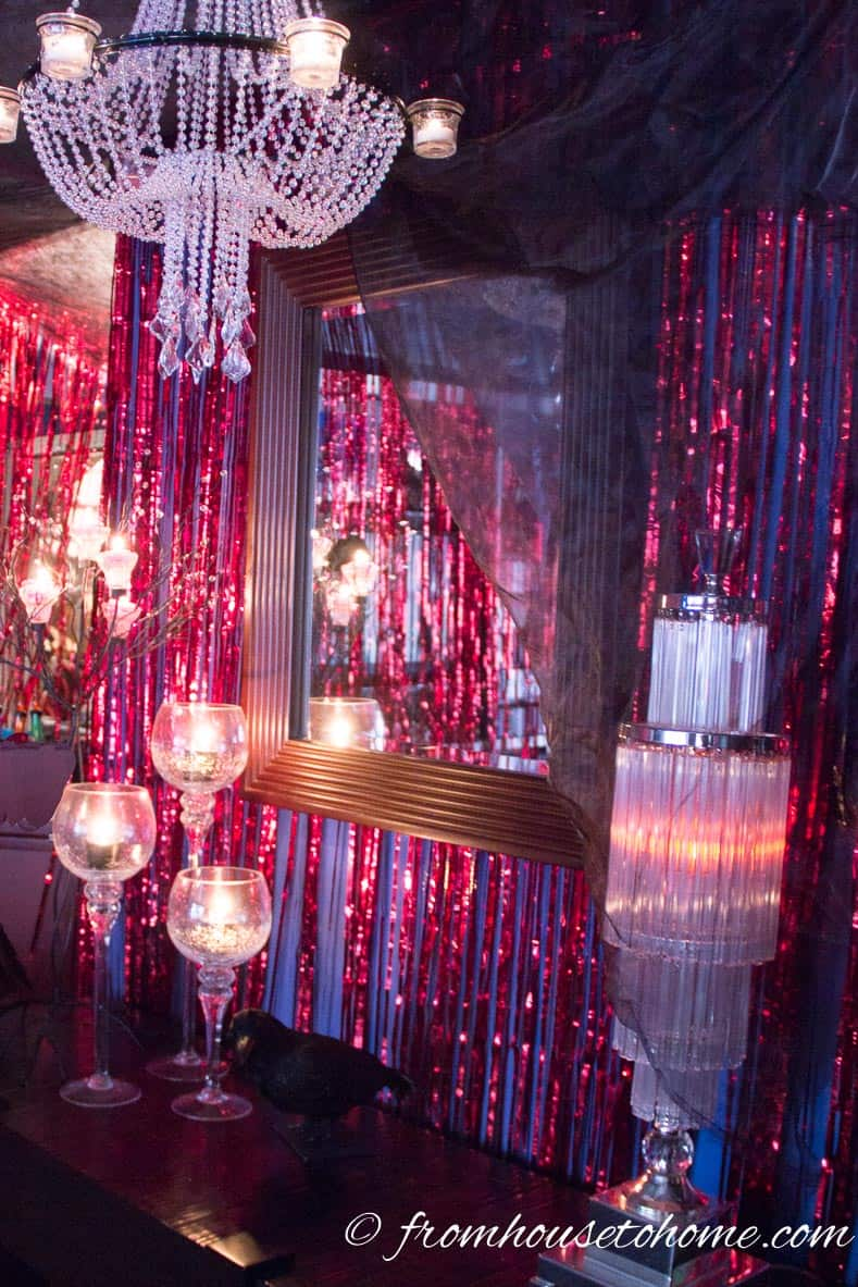 Red foil curtains and red curtains add to the devil decor - Fallen Angels and Devils Party | www.fromhousetohome.com/entertainingdiva