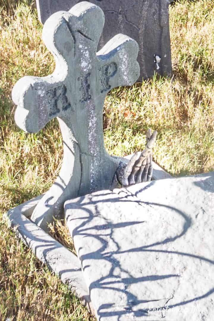 Skeleton hand coming out of Halloween grave