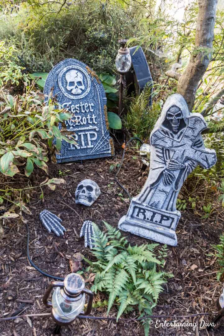 Skeleton bones scattered in front of tombstones in a Halloween cemetery