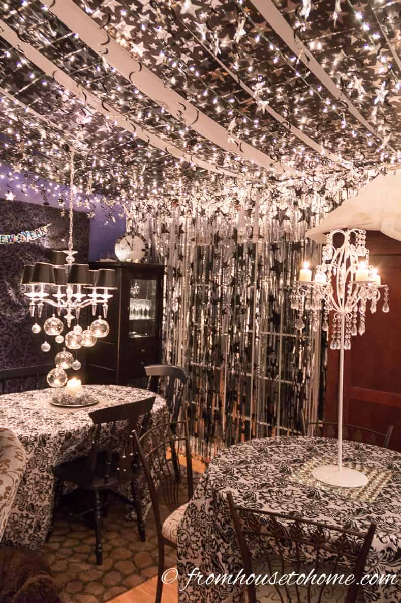 White lights and stars hung from the ceiling | Easy Last Minute New Year's Eve Party Decorations Ideas