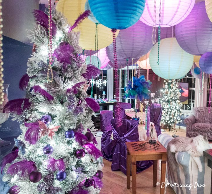 Mardi Gras Christmas tree decorations with purple feathers