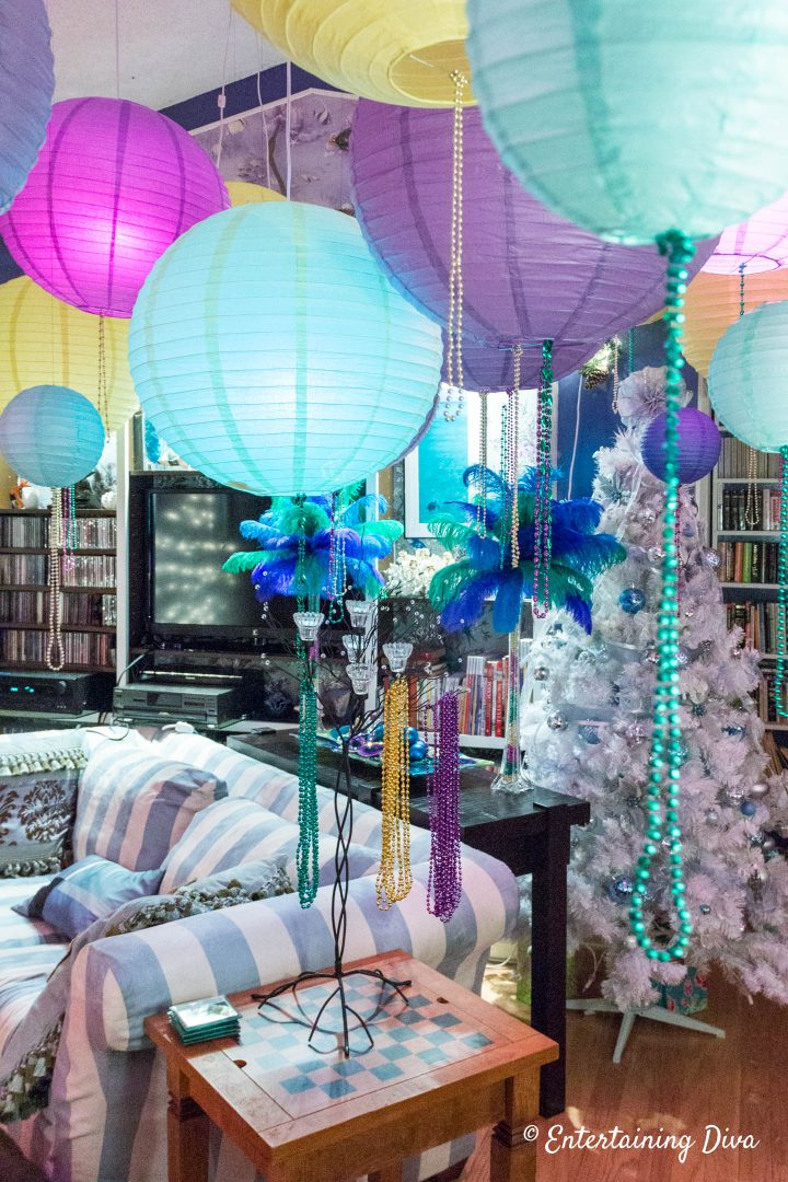 Mardi Gras party decorations with paper lanterns and beads