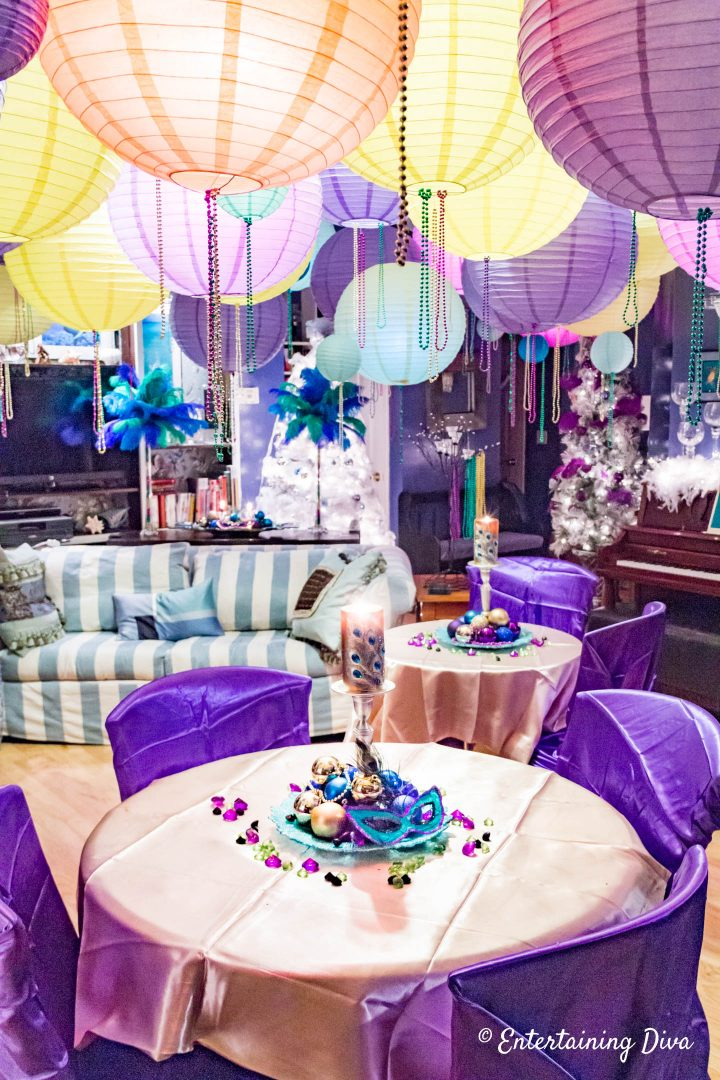 Mardi Gras room decorations with purple chair covers and gold tablecloths