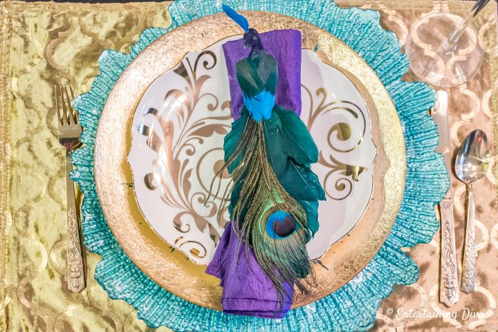 Mardi Gras tablescape with peacock napkin ring
