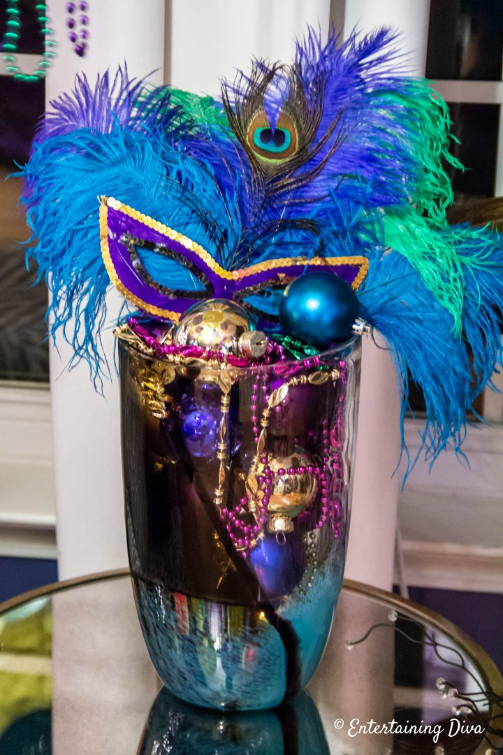 Mardi Gras centerpiece in a vase with ostrich and peacock feathers