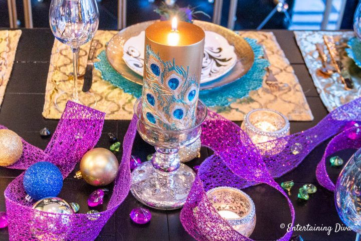 Peacock inspired centerpiece as Mardi Gras table decor