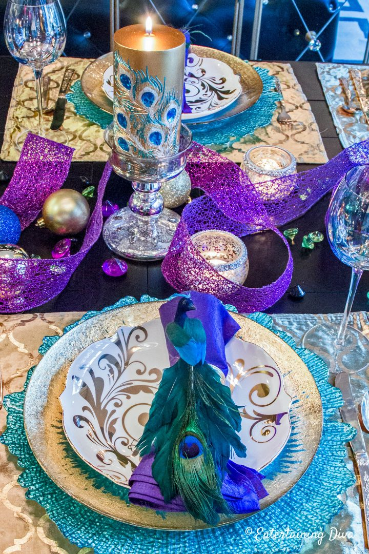 Peacock place setting and centerpiece on a Mardi Gras table setting