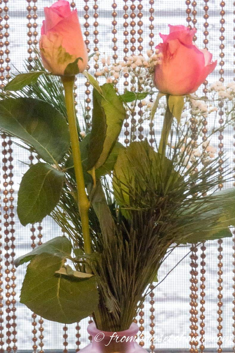 Roses in a simple vase add to the elegance