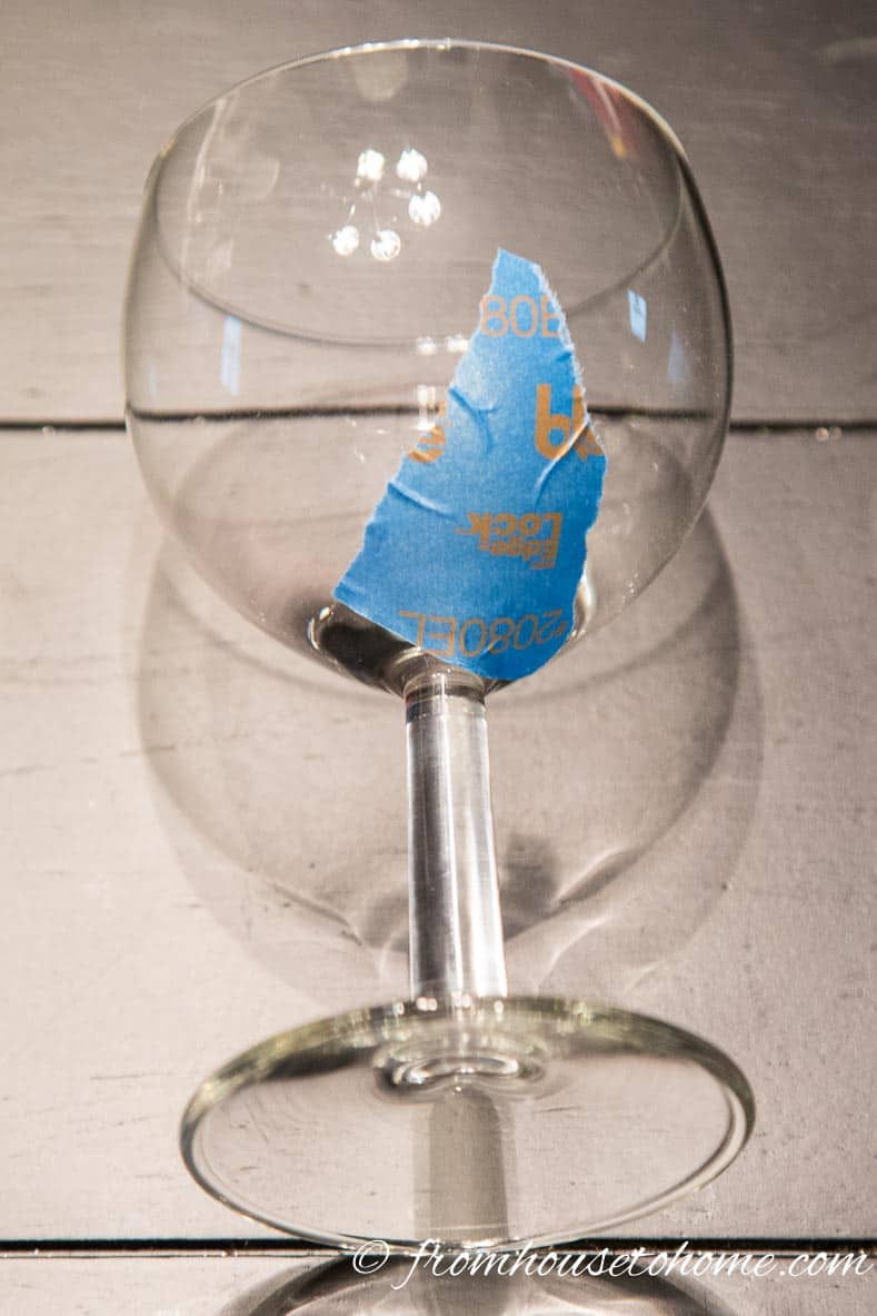 Use small pieces of tape to cover the bottom of the wine glass