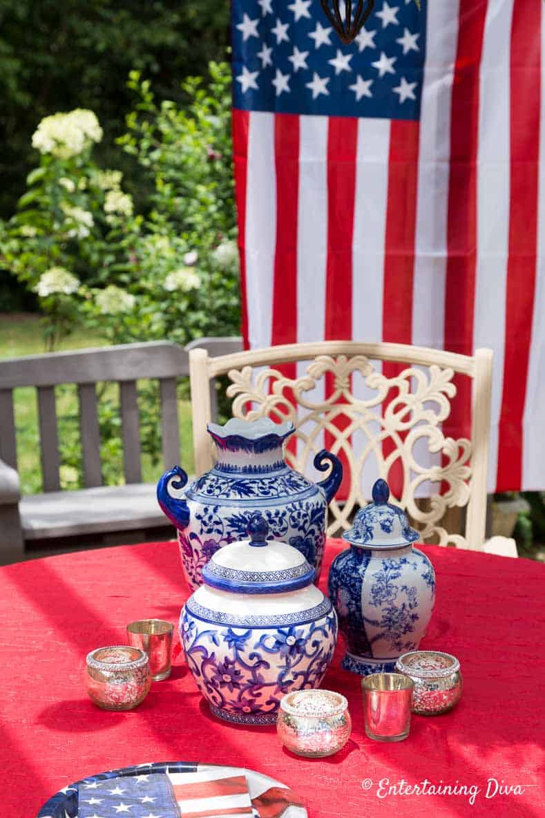 Blue and white vases with a red tablecloth are another way to create July 4th patriotic decor