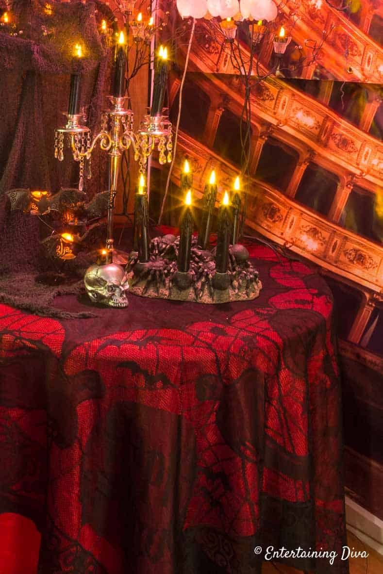 Halloween haunted house black lace over red table cloth
