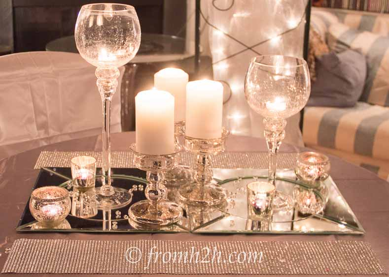 Putting candles on top of mirrored chargers adds to the sparkle | Winter Wonderland Party Ideas