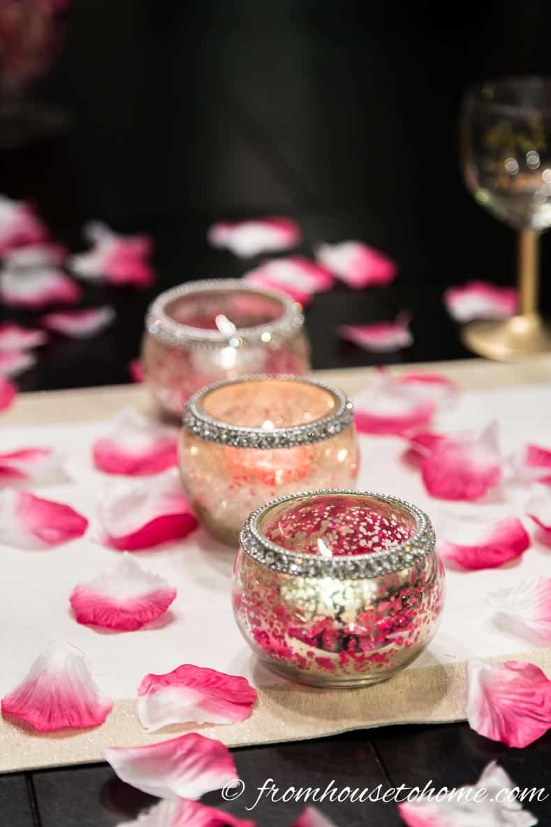Candles and rose petals | How to create a romantic Valentine's Day table setting