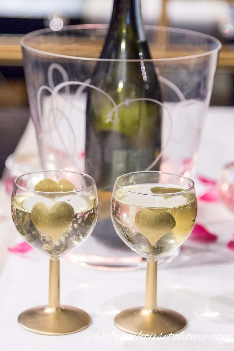 Using an ice bucket with the heart motif is an extra added touch | How to create a romantic Valentine's Day table setting