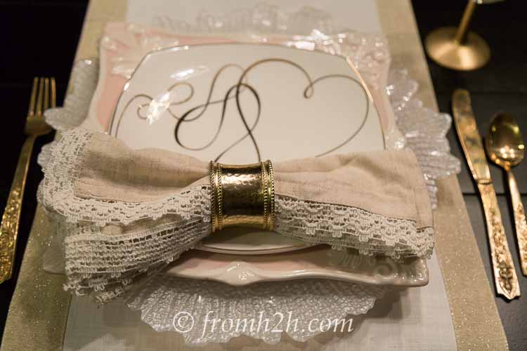 The gold napkin ring ties in with the other gold accents on the table | How to create a romantic Valentine's Day table setting