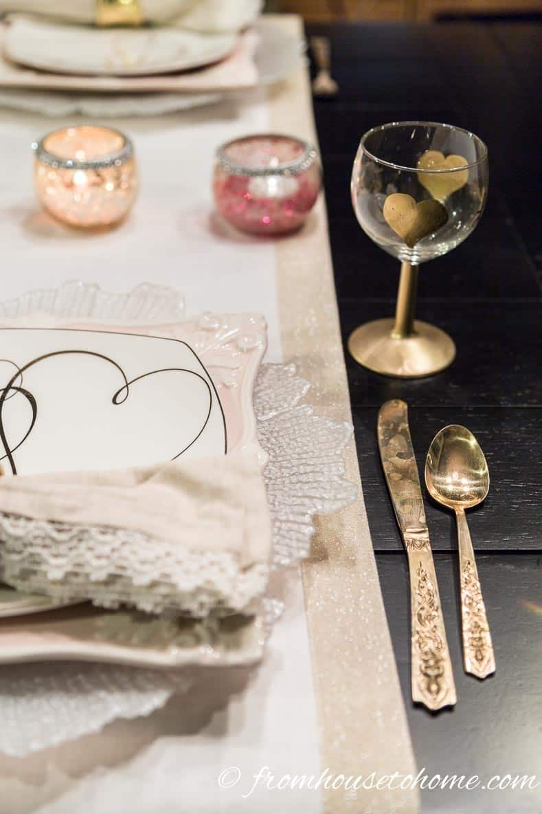 A gold edged runner instead of a place mat | How to create a romantic Valentine's Day table setting