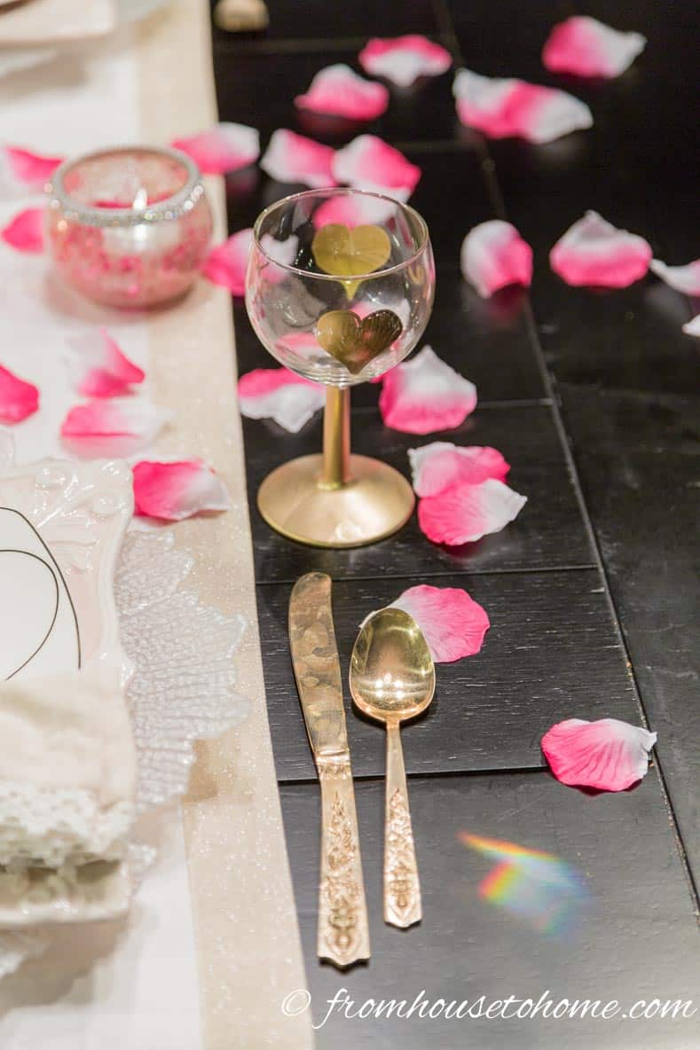 Wine glass with rose petals | How to create a romantic Valentine's Day table setting