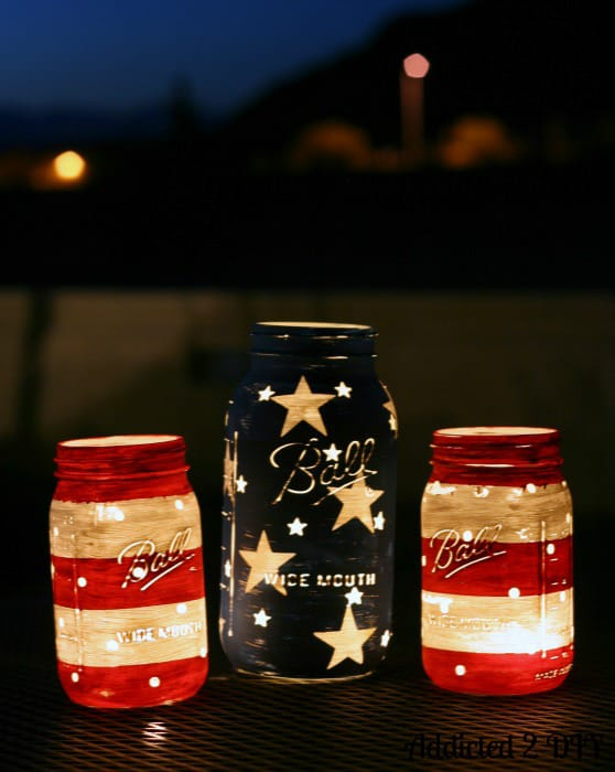 Patriotic Mason Jar Candleholders are another of the Easy Fourth Of July Ourdoor Decor Ideas