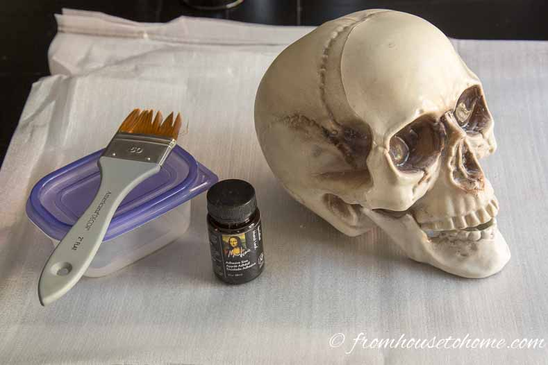 Brush adhesive size on to the skull