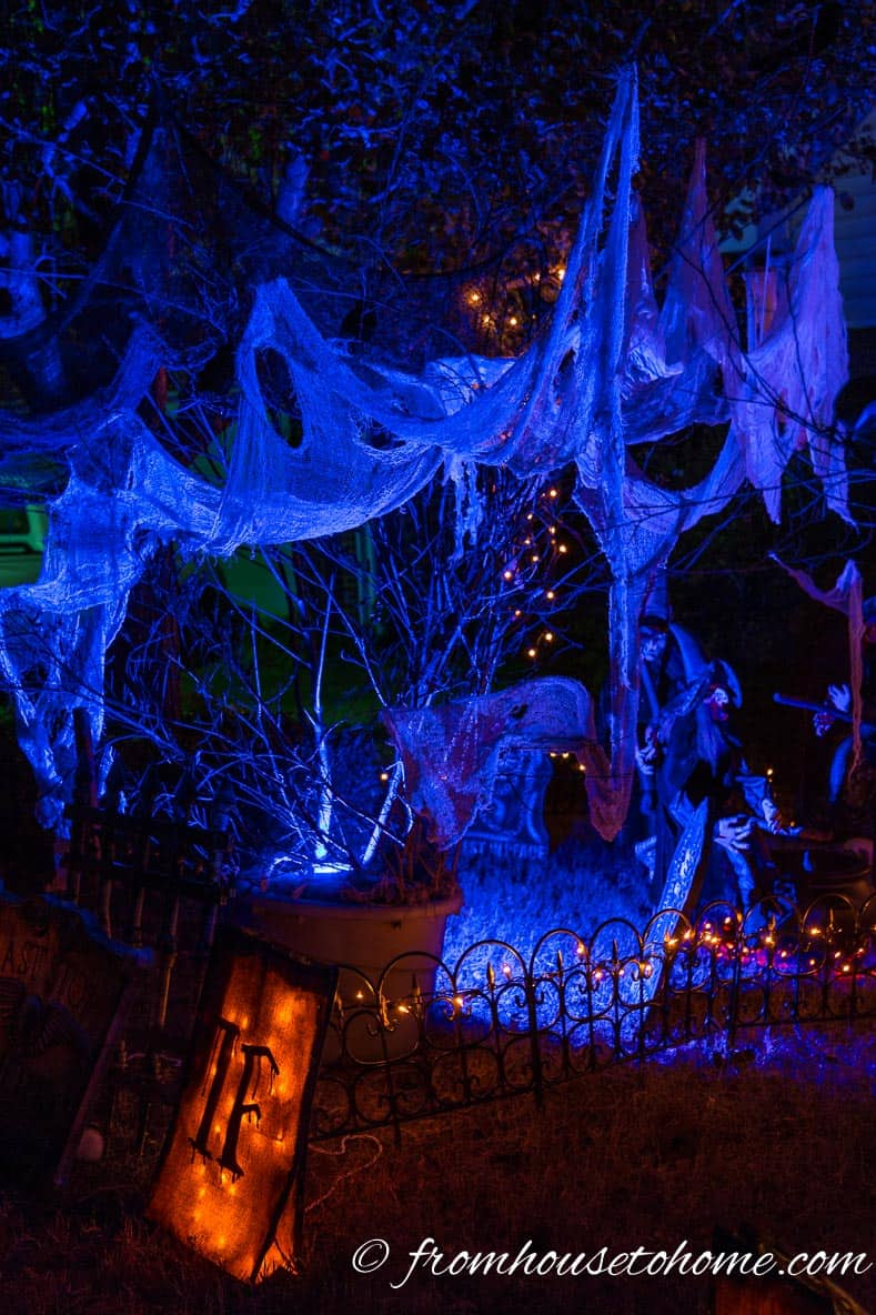 Spooky blue light in Halloween outdoor yard display