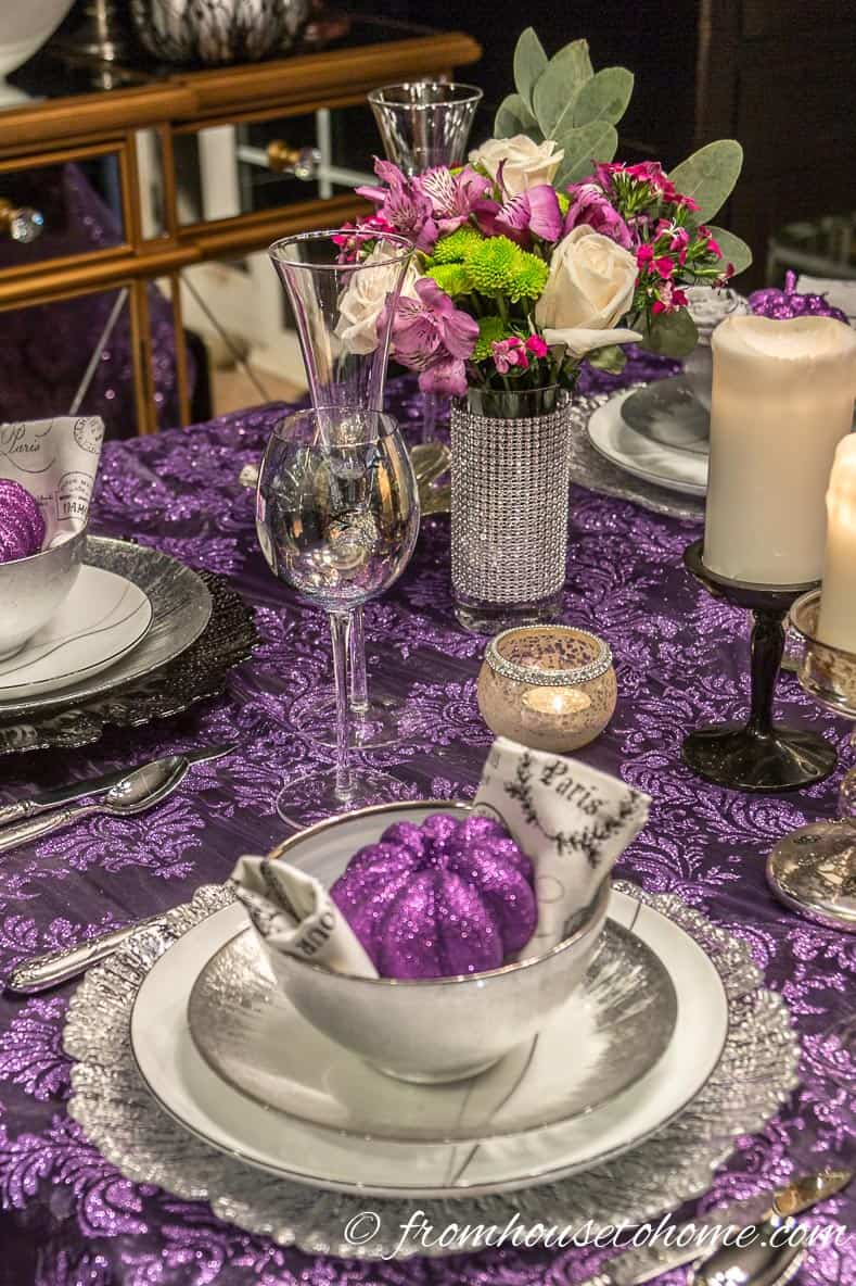 Purple Thanksgiving table centerpiece with flowers