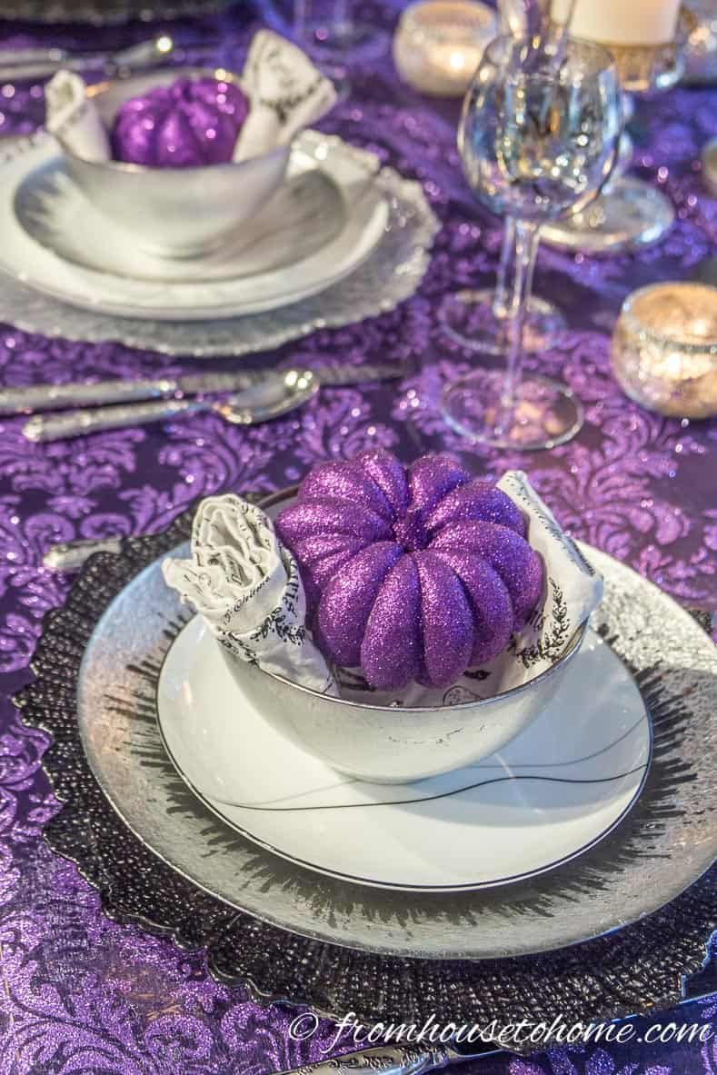 Purple thanksgiving table with glitter pumpkins