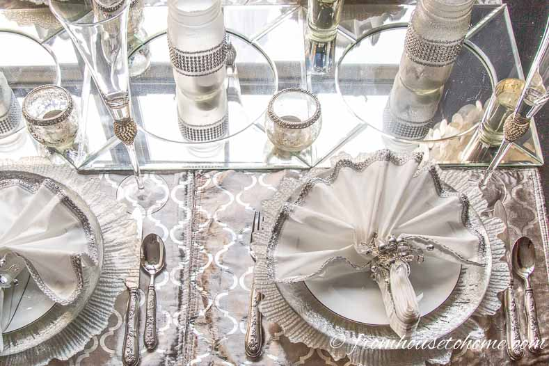 Cover the table with silver placemats and mirror chargers | Silver and White Winter Table Setting