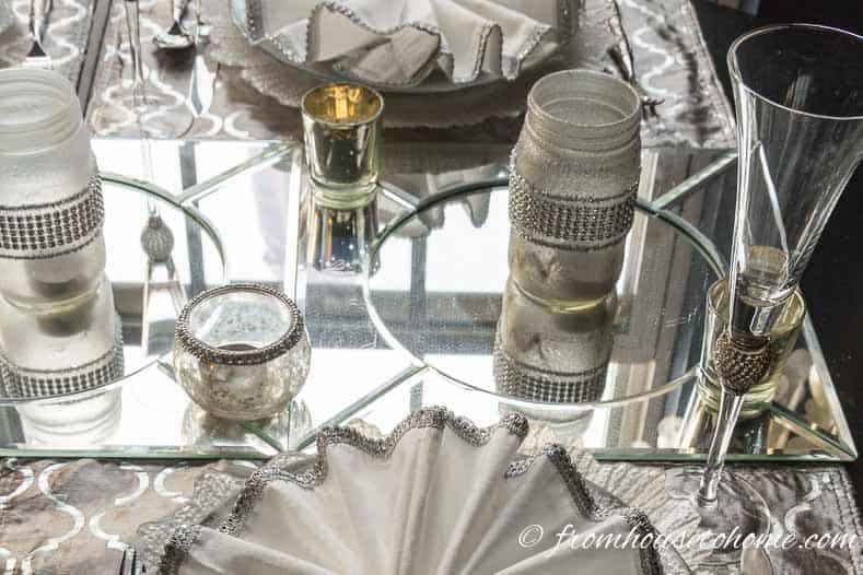 Mirror chargers work well under candles | Silver and White Winter Table Setting