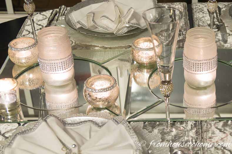 The candle light is reflected in the mirror chargers | Silver and White Winter Table Setting