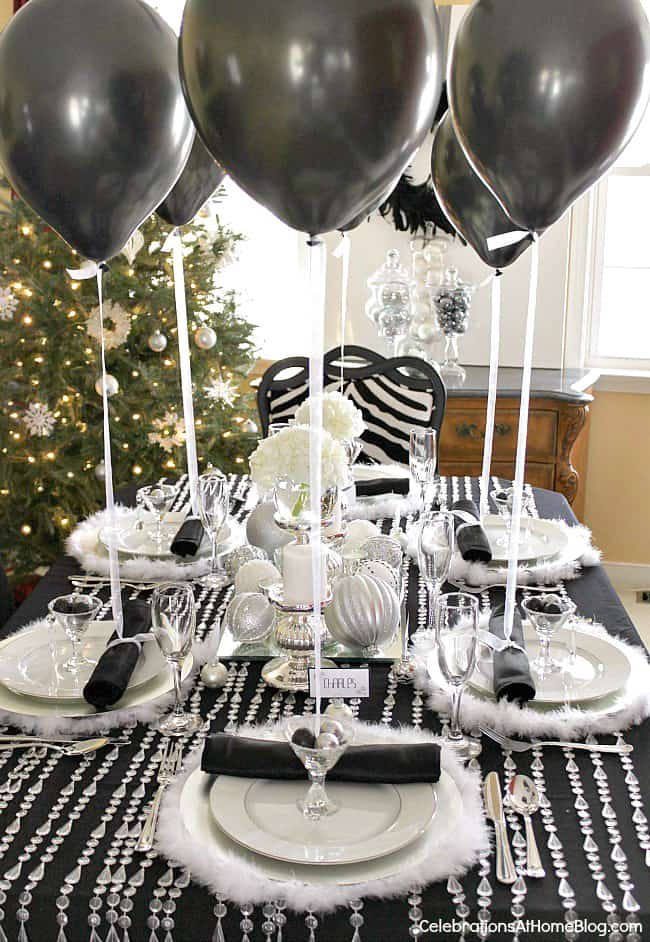 Balloons make an interesting table decoration via celebrationsathomeblog.com | Easy Last Minute New Year's Eve Party Decorations Ideas
