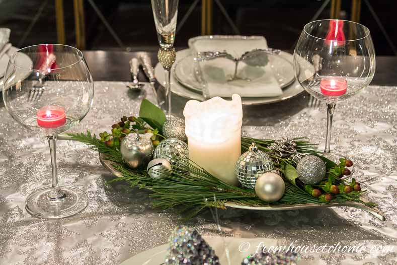 Add a candle, some evergreens and some Christmas ornaments to a tray | Easy Last Minute Christmas Table Ideas