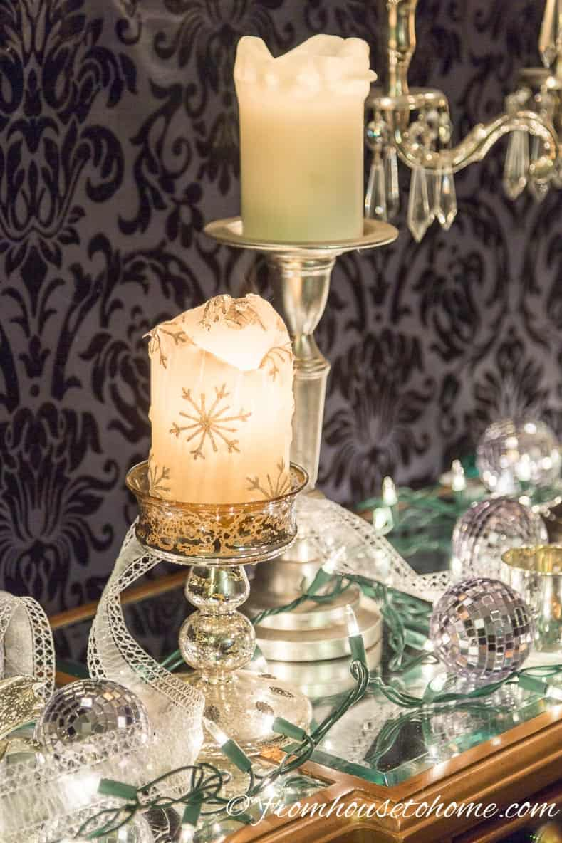 White candles and lights sparkle in the mirror on the buffet | Easy Last Minute Christmas Table Ideas