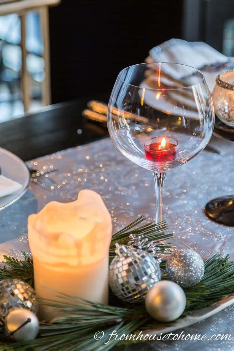 A wine glass with a tealight candle | Easy Last Minute Christmas Table Ideas