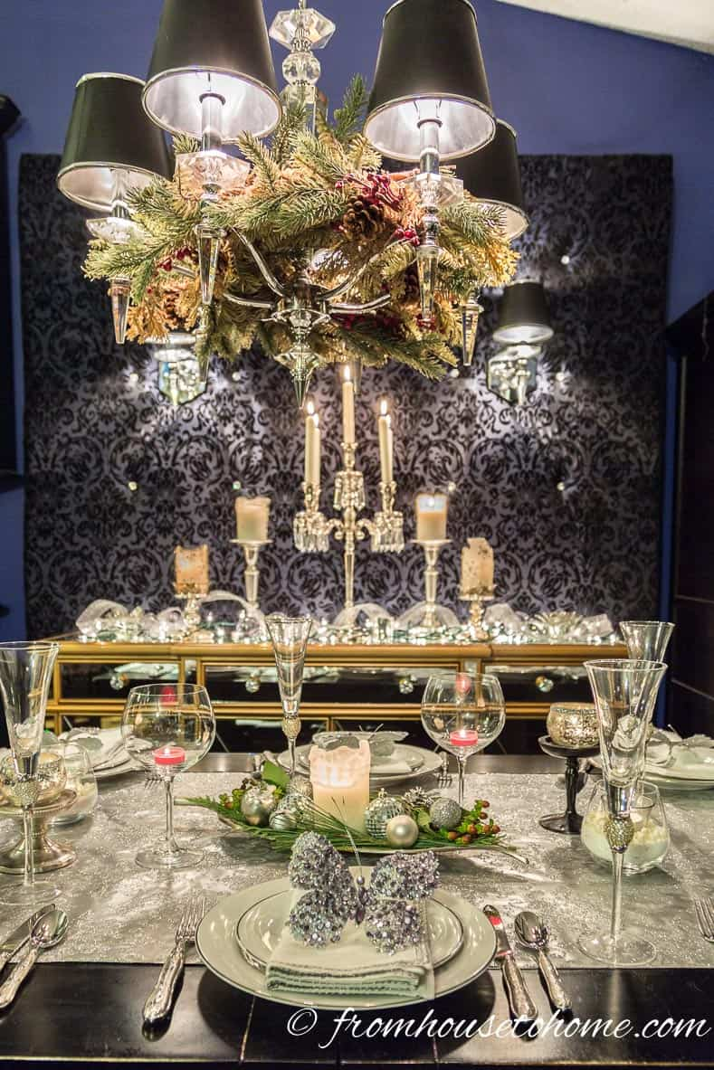 Add a garland to the chandelier | Easy Last Minute Christmas Table Ideas