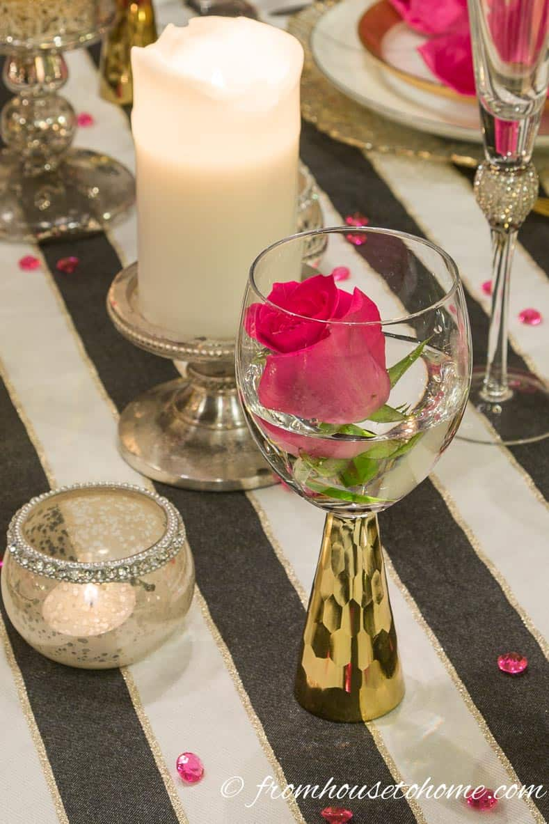 Pink roses in gold stemmed wine glasses | Kate Spade Inspired Table Setting