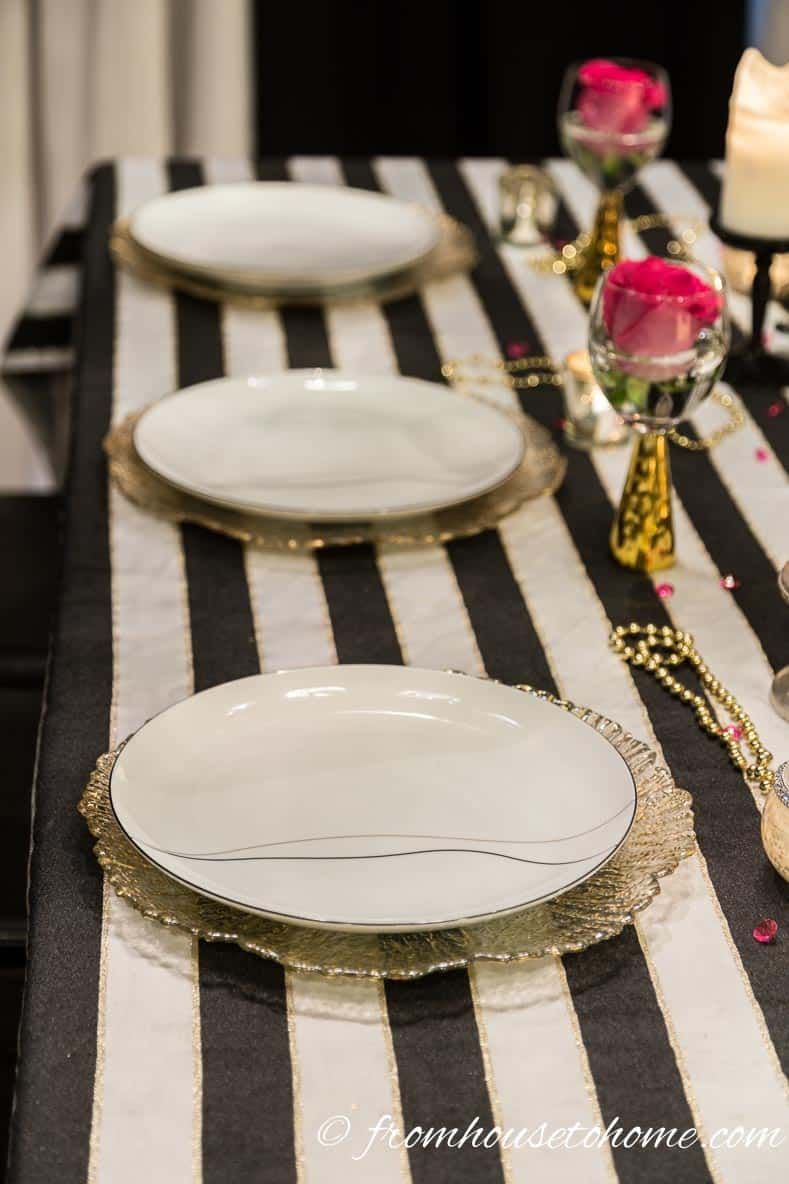 Black and white plates with gold chargers | Kate Spade Inspired Table Setting
