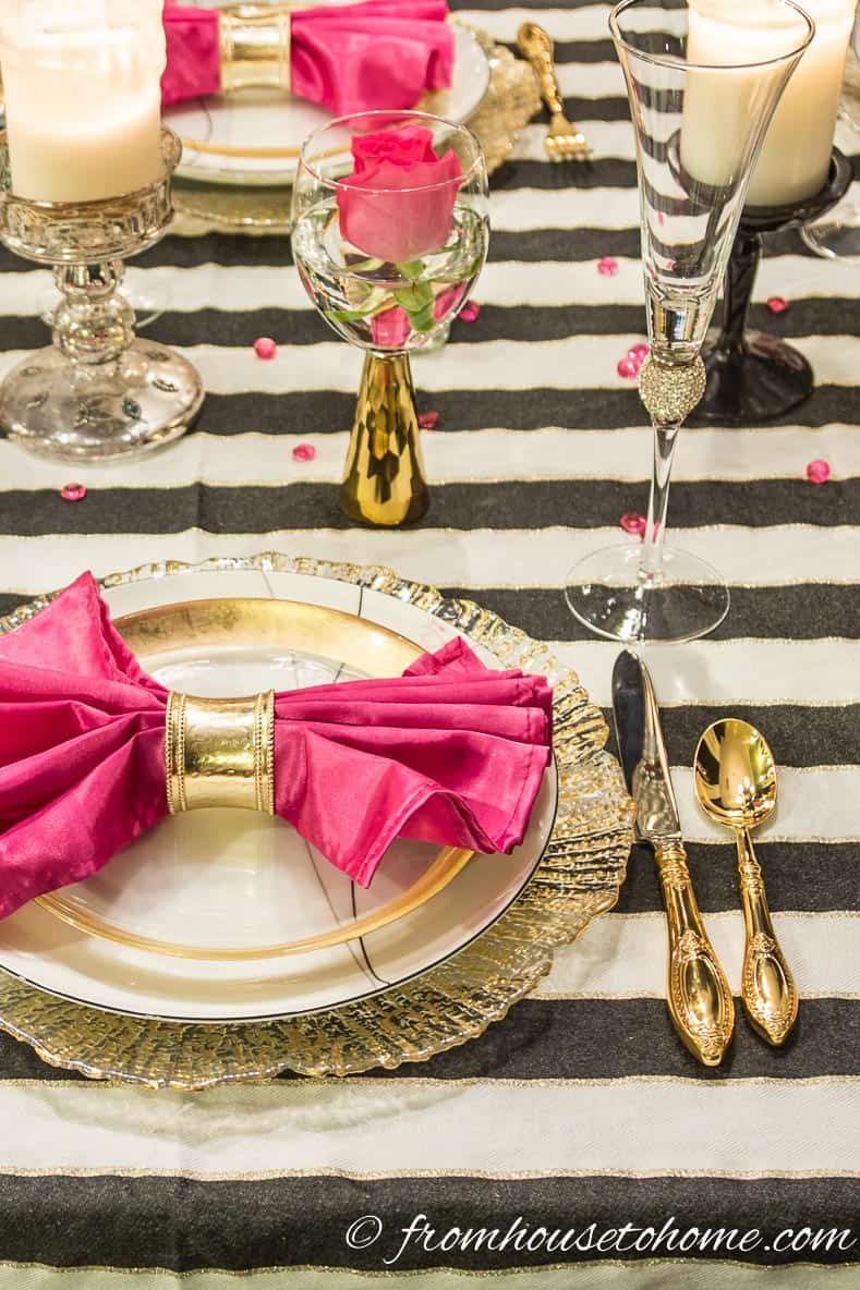 The pink stands out against the black and white table cloth | Kate Spade Inspired Table Setting