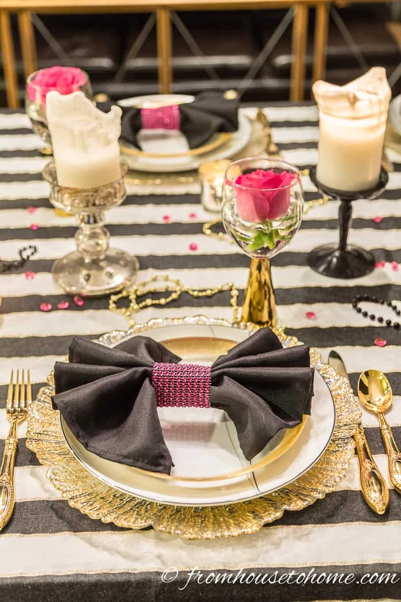 Add black napkins with pink napkin rings to echo the pink roses | Kate Spade Inspired Table Setting