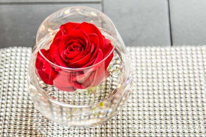Brunch centerpiece made from a rose in a stemless wineglass