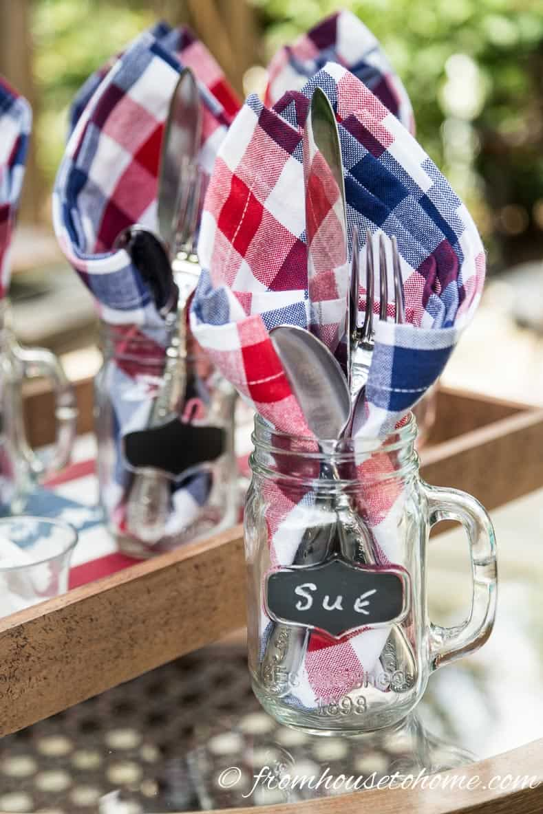 Cutlery and napkins in a mason jar is an easy way to serve for 4th of July bar-b-ques