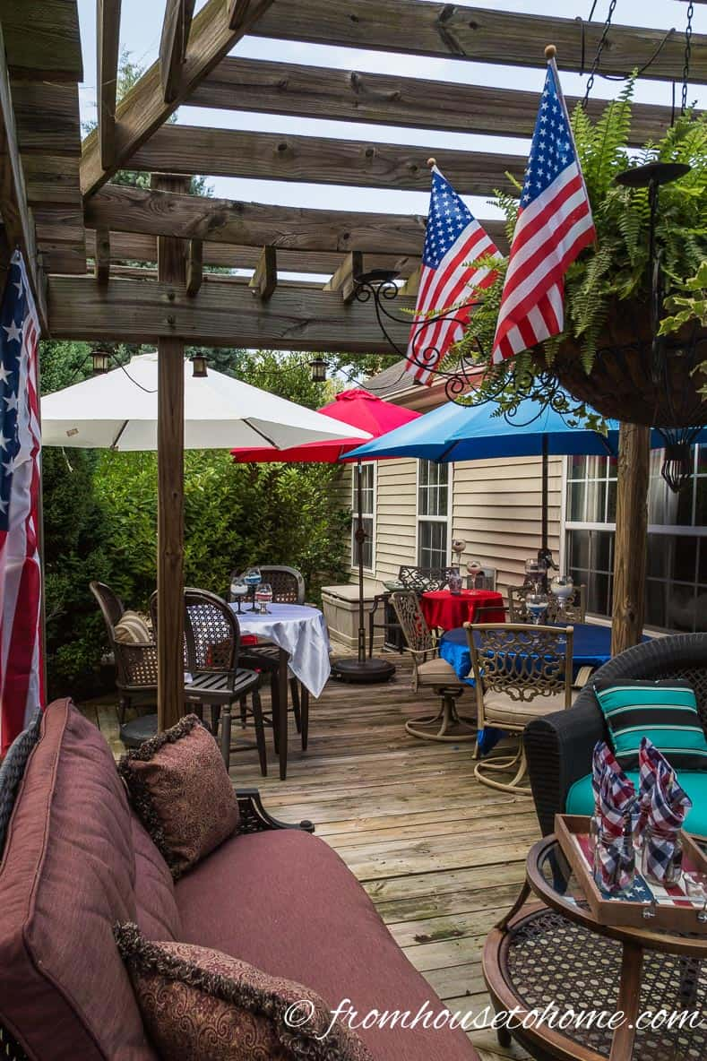 American flags co-ordinate with umbrella covers for more Easy Independence Day Outdoor Decor Ideas