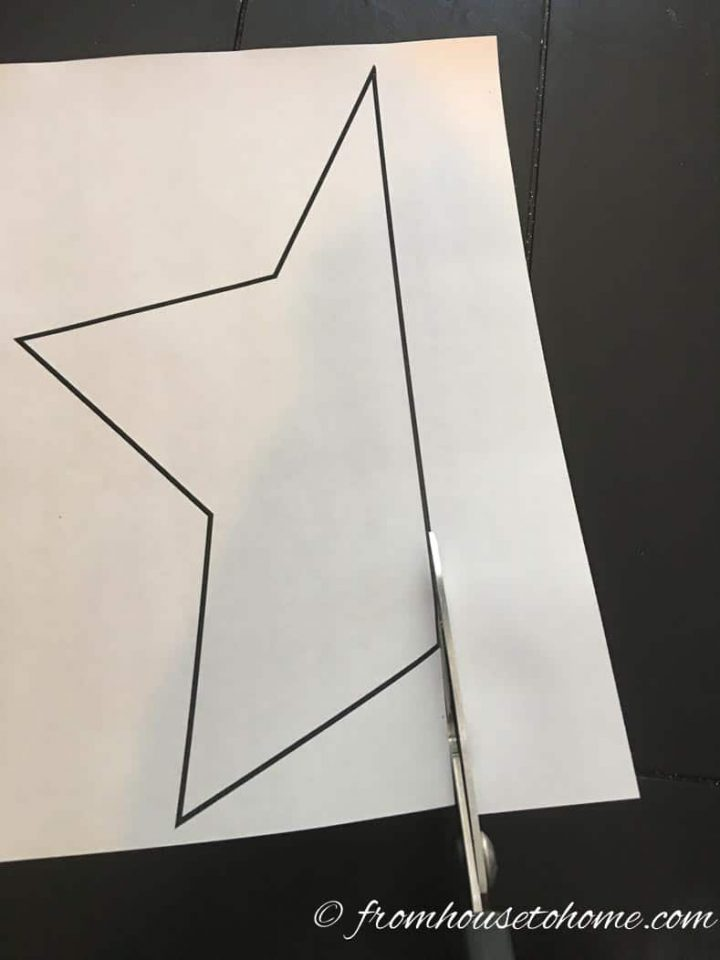 Star pattern being cut from paper