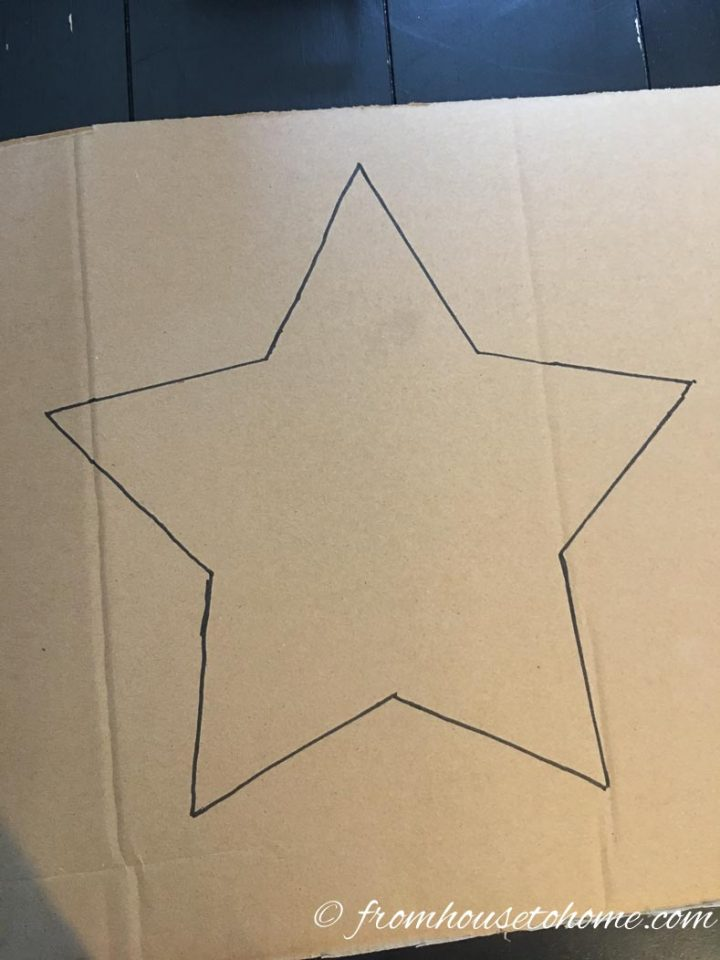 Square piece of cardboard with a star drawn on it