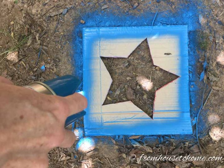 Blue spray paint outlining the star template