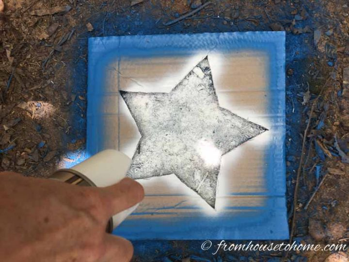 White star being painted in the middle of a blue square